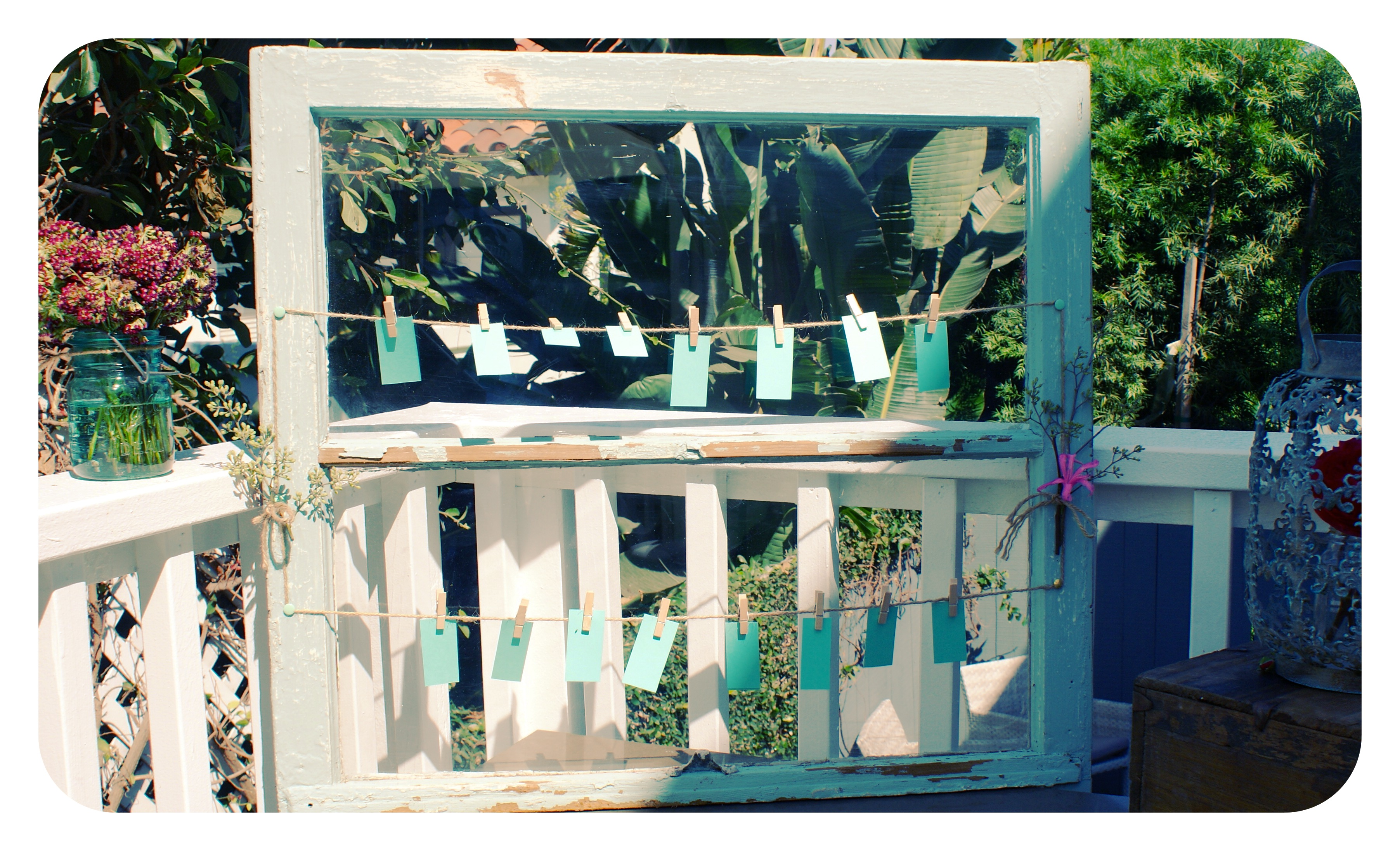 i found an old window frame that i cleaned up and painted it was used to post note cards for baby name ideas